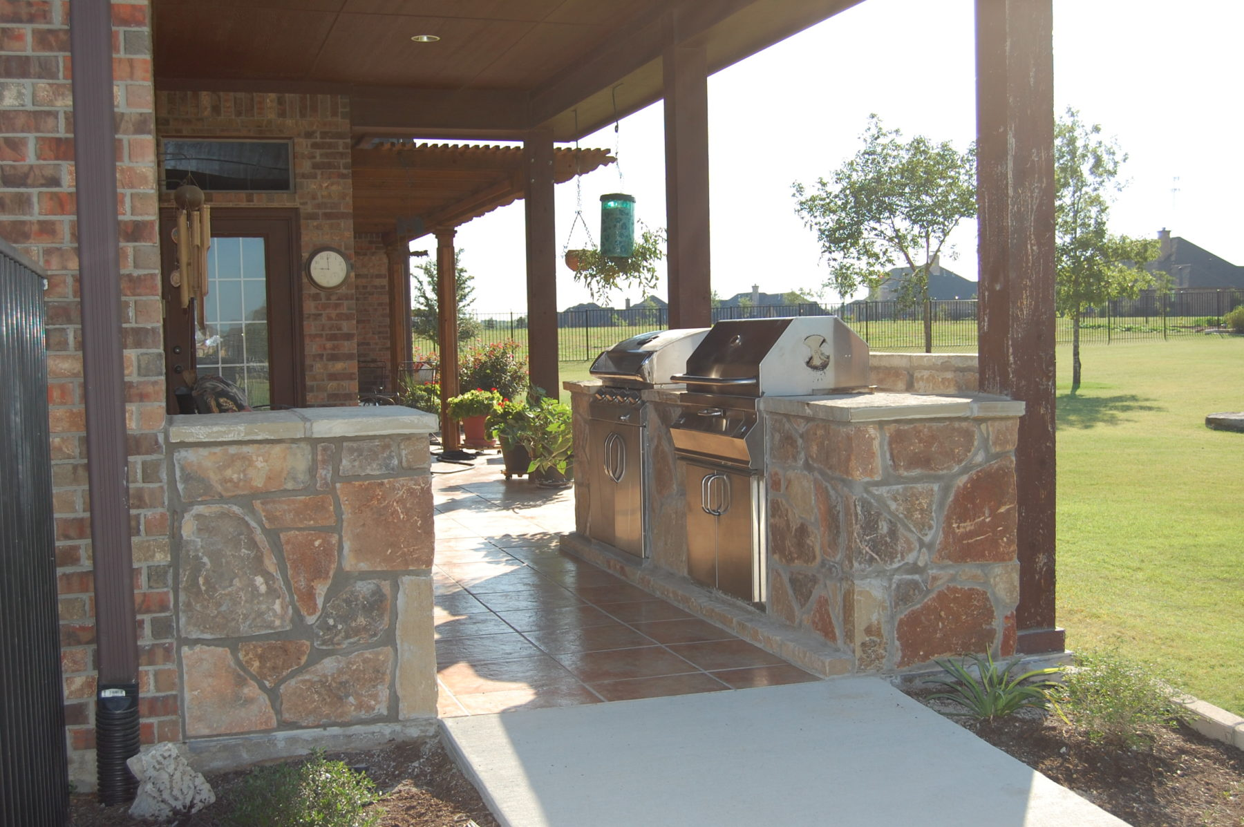 Outdoor kitchens custom patio designs forney tx for Outdoor kitchen patio ideas